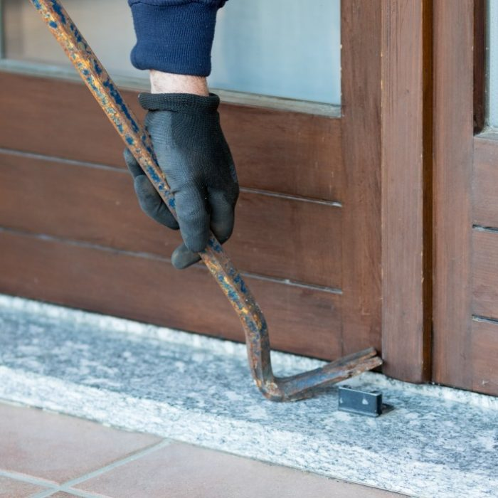 milan-italy-november-18-2017-a-thief-trying-to-burden-a-window-door-with-the-crowbar-to-enter-the_t20_wQXW9L